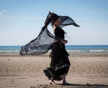 Woman in black on beach
